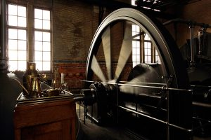 operating-steam-engine-with-running-fly-wheel-by-mgfoto-via-istock