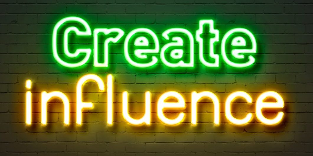 Create influence neon sign on brick wall background.