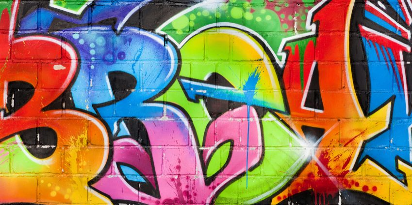 detail-of-graffiti-painted-illegally-on-public-wall-via-istockphoto
