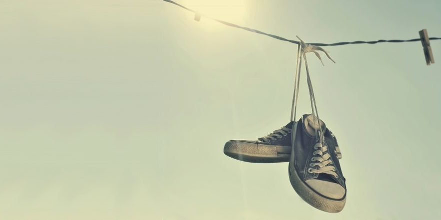 dirty-sneakers-hanging-on-the-clothesline-by-orla-via-shuterstock