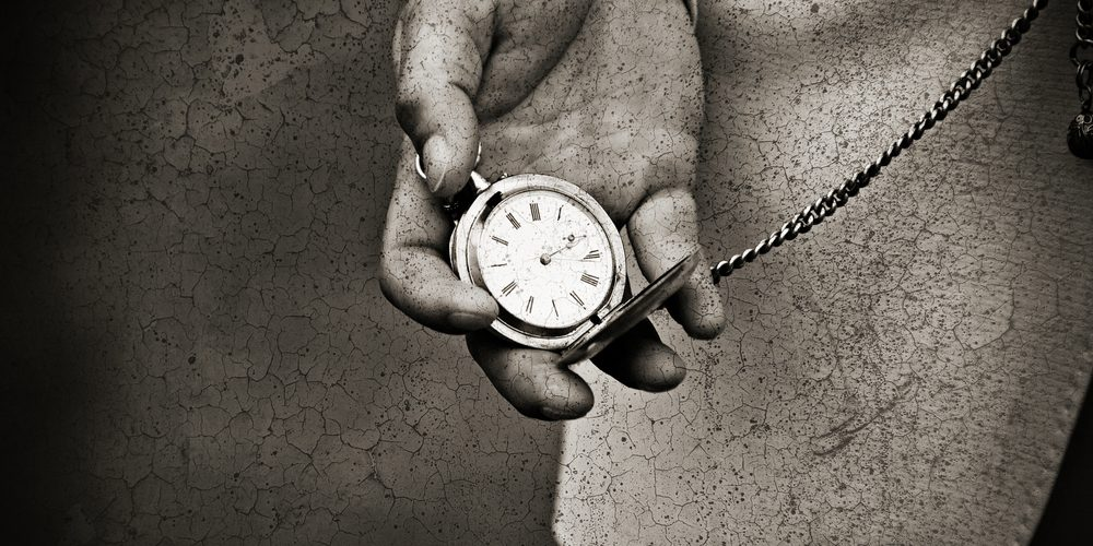 old-watch-in-the-hands-by-kristina-stasiuliene-vua-shutterstock