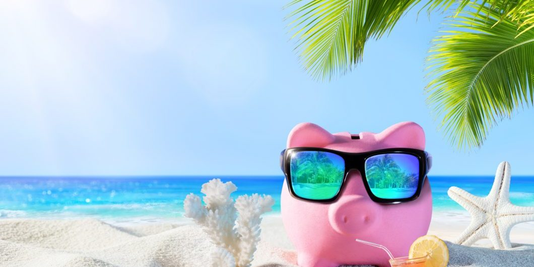 piggy-bank-with-sunglasses-on-the-beach-holiday