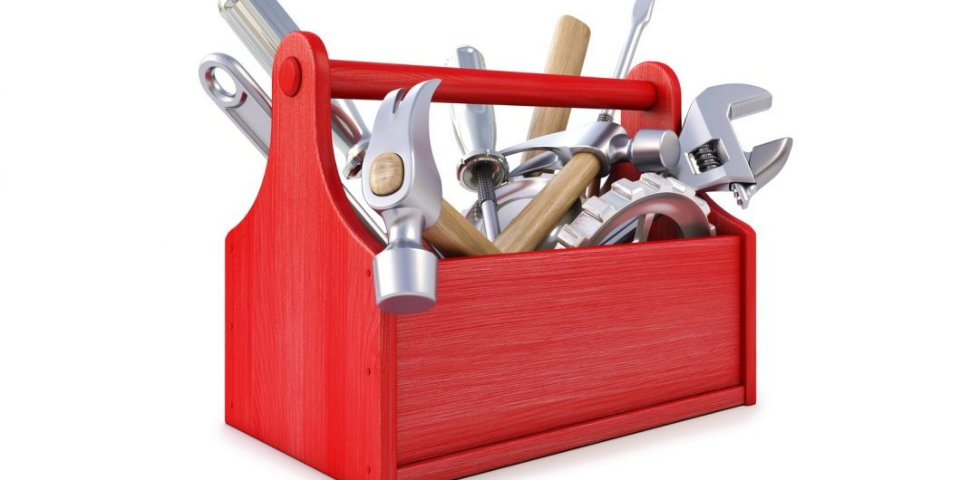 wooden toolbox with tools-by-dim-dimich-via-shutterstock
