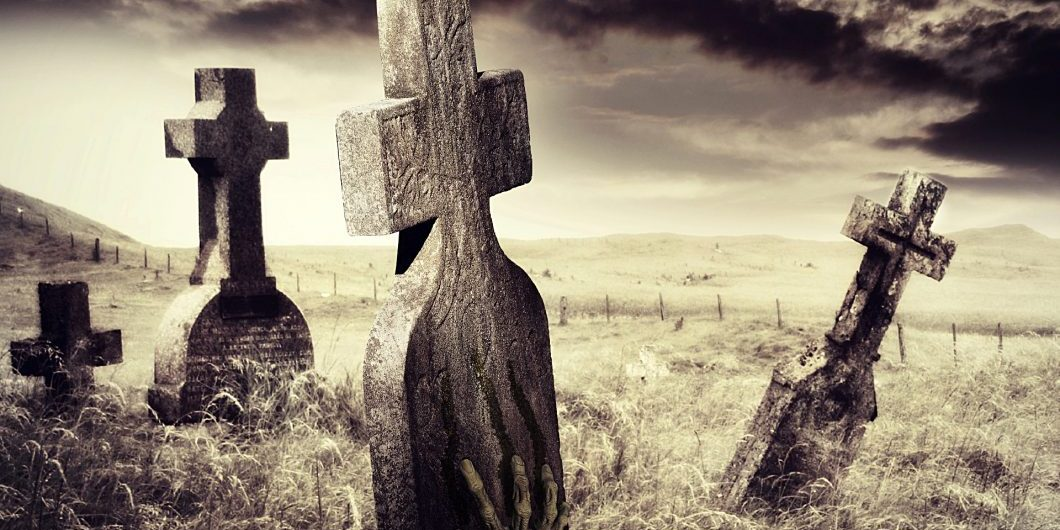 zombie-hand-scratching-marks-on-tombstone-by-la_corivo-via-istock